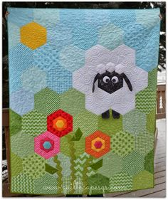 Deonn's Hexie Sheep in the Meadow, featured on the cover of the May/June 2014 episode of Quiltmaker Magazine