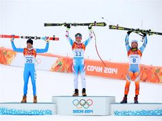 Sochi 2014 Day 3 - Alpine Skiing Men's Downhill Silver medalist Christof Innerhofer (L) of Italy, gold medalist Matthias Mayer (C) of Austria and bronze medalist Kjetil Jansrud (R) of Norway stand on the podium during the flower ceremony for the Alpine Skiing Men's Downhill at Rosa Khutor Alpine Center