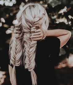 Double fishtail braids, thick and long blond braids.