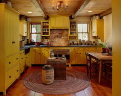Oh love the mustard yellow cabinets.  Such a warm kitchen!