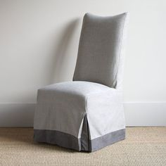 PAULETTE SIDE CHAIR from Bungalow Classic. Nice way to upholster the hem of the chair.
