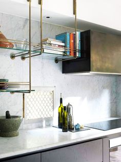 Brass and Glass Kitchen Shelves Kitchen Inspiration | The Kitchn  So creative! Danya, ABV Glass Girl A Better View Glass & Mirror www.WantABetterView.com