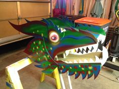 Chinese dragon head built for my wife's classroom. By Todd Van Fleet. Made with cardboard, foam core and lots of hot glue. Painted with spray paint.