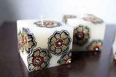 Square candles with black henna flowers