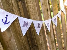 Lovely fabric Mr & Mrs anchor wedding banner. Each flag measures approximately 7.5 x 7.5 inches with a total length of approximately 60 inches across.