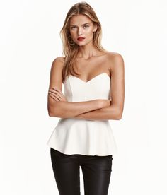 Check this out! V-neck top in woven, crêped fabric. Narrow, detachable shoulder straps, silicone trim inside upper edge, boning at sides, and concealed side zip. Seam at waist and wide, flared peplum. Lined. - Visit hm.com to see more.