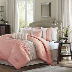 Amherst's modern color blocked design is a simple way to add style to your room. This comforter is covered in larges stripes in shades of coral and taupe. Made from polyester jacquard and a brushed fabric reverse this comforter is soft to the touch and is machine washable for easy care. The comforter set includes two matching standard shams and three decorative pillows that accent the color blocked look.