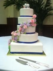Wedding cake with roses going down on the side of the cake. #roses #weddingcake #SBIN