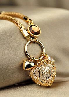 Gold filigree heart. Love the mixture of textures and elements in this one piece