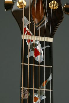Steel string guitar by Michihiro Matsuda. Custom inlay done by Larry Robinson.  Copyright © 2006 Matsuda Guitars.