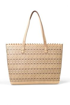 Tote around in style with the unique laser cut out Avalon tote bag from Stella & Dot. Our totes, satchels & weekenders are perfect for any woman on the go.