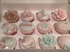 Pastel fondant cupcakes with sugar art