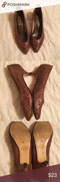 Rush hour brand brown shoes EUC size 7B Brown pumps with little cut outs. Very comfortable. 2 inch heel. Leather made in Brazil. Worn with black and brown outfit available in my closet Rush hour Shoes