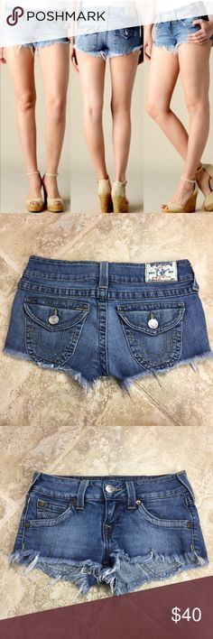 TRUE RELIGION Joey Cut Off Jean Shorts These shorts are in very good condition! No marks. 98% cotton 2% spandex. Fabric has lots of stretch to it. 15 inches across the waist. 7 inch rise. Non-smoking pet free home.                                                                               🔹suggested user🔹fast shipper🔹                                    🔸bundle to save 15%🔸300+ items🔸 True Religion Shorts Jean Shorts