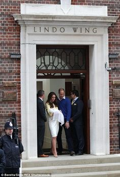 The moment the family first stepped through the doors of the Lindo Wing with Prince William helping his wife down the steps.