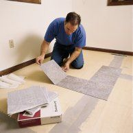 How to Lay a Vinyl Tile Floor A step-by-step guide to preparing the floor and installing peel-and-stick tiles Laying Vinyl Flooring, Vinyl Tile Flooring, Vinyl Tiles, Diy Flooring, Flooring Ideas, Laying Tile, Tiled Floors, Vct Tile, Tile Floor Diy