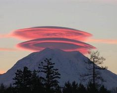 Lenticular clouds are stationary, lens-shaped clouds that form at high altitudes, normally aligned perpendicular to the wind direction. Photo by Dahlia Rudolph, October 2011