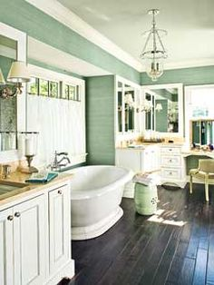 My dream bathroom.    The dark hardwood floors throughout this serene space make it a luxurious place for pampering. It's spacious enough for two to easily share and comes with lots of storage space to keep unsightly supplies out of view.