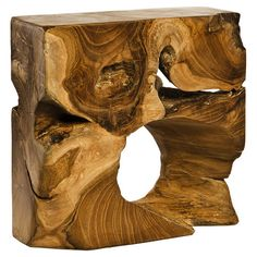 Handcrafted teak wood sculpture with an abstract design.   Product: SculptureConstruction Material: Teak