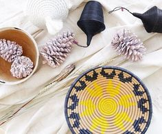Baskets for the holidays. 🎄 Check out this Starburst Plateau Basket, made with sweetgrass and hand dyed sisal by the artisans of Indego Africa in Rwanda. | Jimani Collections
