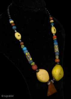 Noire Ivoire Tribal Art Designs | Old Venetian Millefiori beads are combined with yellow Kiffa glass beads from Mauritania, and other Goblonz and Bohemian African Trade Beads