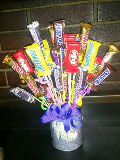 Candy bouquet with oragami money on the bow :)  oooh I'm making this for my cousins graduation!