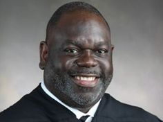 A Black Mississippi Judge's Breathtaking Speech To 3 White Murderers | http://www.npr.org/blogs/codeswitch/2015/02/12/385777366/a-black-mississippi-judges-breathtaking-speech-to-three-white-murderers?   U.S. District Judge Carlton W. Reeves, for the Southern District of Mississippi.