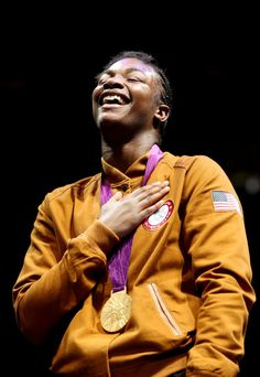 Gold medalist Claressa Shields of the United States celebrates on the podium during the medal ceremony for the Women's Middle (75kg) Boxing final bout on Day 13 of the London 2012 Olympic Games at ExCeL on August 9, 2012 in London, England.