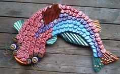 A new take on a Louisiana catfish. Thanks, Ann Drorbaugh, for sharing your beautiful artwork with us. #craftbeer pic.twitter.com/kFKQ4n26MN  Cool way to use all those beer bottle caps!