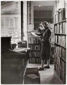 Sylvia Beach reads in the upstairs apartment where she hid her books during the German occupation of Paris (1945).