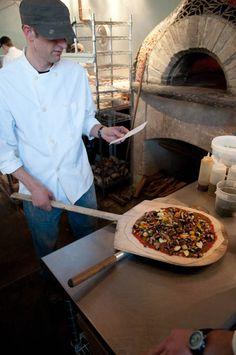 Scott Unfried checks the order against the pizza