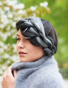 Beret - A style that evokes the 1920s, this updo features two French braids that melt into each other.
