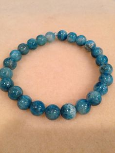 Sea Blue Green Apatite 8mm Round Stretch Bead Bracelet with Sterling Silver Accent https://www.etsy.com/listing/259463874/sea-blue-green-apatite-8mm-round-stretch
