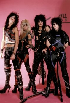 Hair metal kings Motley Crue — Tommy Lee, Vince Neil, Nikki Sixx and Mick Mars pose for a shot, Jan. 1984