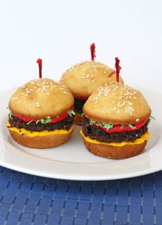 hamburger cupcakes - vanilla cupcakes, chocolate cupcakes/brownies, coconut dyed with green food dye, red and yellow frosting.