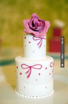 Wow! - Pink stars and bows adorn a miniature wedding cake topped with a pink bow. | CHECK OUT MORE GREAT PINK WEDDING IDEAS AT WEDDINGPINS.NET | #weddings #wedding #pink #pinkwedding #thecolorpink #events #forweddings #ilovepink #purple #fire #bright #hot #love #romance #valentines #pinky
