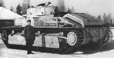 Finnish tanker is photographed standing next to a captured Soviet T-28 tank. This machine is one of the two captured by Finnish troops in December 1939, from the 20th Heavy Tank Brigade Kirov. #worldwar2 #tanks