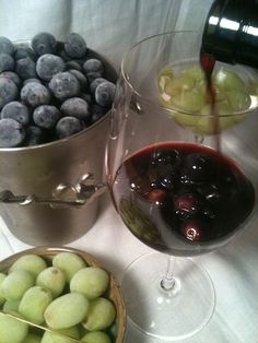 frozen grapes as ice for wine...GREAT idea!...or at our house for punch, juice or ginger ale.  :)
