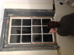 Working on the sash window in the kitchen