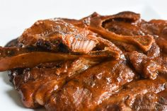 BBQ Pork Steaks in the Slow Cooker: Cook in the crockpot with sauce, & after a few hours they'll be so tender they'll fall off the bone! Quick & Easy!