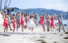Turquoise Ties for the Groomsmen, and Coral Bridesmaid Dresses for the girls. Beautiful beach wedding colors against sand and ocean. Love the picture idea as well, captures the excitement and love of the moment.