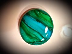 Alcohol ink on white glass gem.