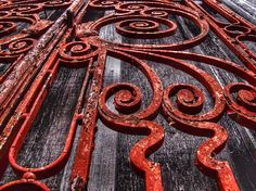 old rusty red swirly gated door
