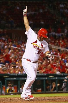 Matt Adams celebrates after hitting a two-run walk-off home run against the Pittsburgh Pirates in the ninth inning. Cards won the game 2-0. 7-07-14