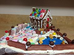 Our annual tradition of making our Pampered Chef Gingerbread House from scratch!