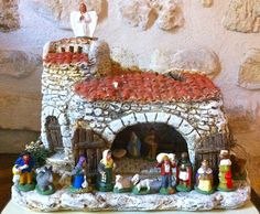 """Santons or """"little saints"""" are small hand-painted terracotta nativity scene figurines produced in Provence. The first clay santons were created by Marseillais artisan Lagnel (1761-1822) during the French Revolution when churches were forcibly closed and their large nativity scenes prohibited. A maker of santons is a santonnier, and the creation of santons today is essentially a family craft, handed down from parents to children."""