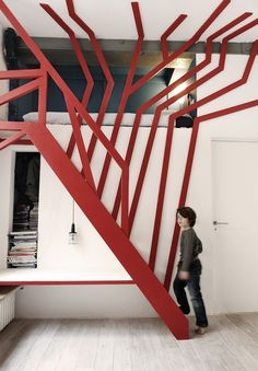 Emphasis: This is an example of emphasis in an interior space because the cal point is the red stairs.  The red stairs have like tree branches coming of of them, and they are bright red.  Meanwhile, the rest of the room is white, so you eyes go right to the color.