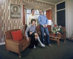 Elton John (right) with his mother Shelia and stepfather Fred Fairebrother in their London apartment. IMAGE: JOHN OLSON/THE LIFE PICTURE COLLECTION/GETTY IMAGES