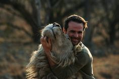 """Kevin Richardson, known as the mighty """"Lion Whisperer""""! As an animal behaviorist, he works with some of the most dangerous animals known to man. He sleeps with lions, cuddles newborn hyenas and swims with lionesses. http://www.lionwhisperer.co.za/gallery.asp?menuId=4# On youtube: http://youtu.be/Zd97TnKlRZM"""