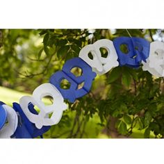 This Oktoberfest decoration is approximately 12 feet long with alternating blue and white Oktoberfest pretzels.